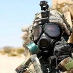 US soldier in chemical weapons gear. Click to enlarge