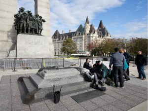 Police, bystanders and soldiers aid Cirrilo soldier at the War Memorial. Click to enlarge