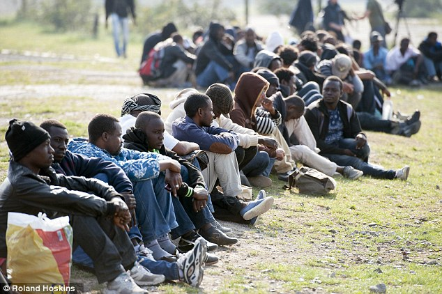 Non-EU migrants waiting to try and enter Britain at the French port of Calais. Click to enlarge