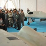 In this picture released by the official website of the office of the Iranian supreme leader, Supreme Leader Ayatollah Ali Khamenei, seated left, listens to an official during his visit at an aerospace exhibition in Tehran, Iran, Sunday, May 11, 2014. The exhibition revealed an advanced CIA spy drone, front, captured in 2011 by Iran, and its Iranian-made copy, back. (AP Photo/Office of the Iranian Supreme Leader) Click to enlarge