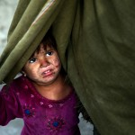 Little girl at a camp for internally displaced near the Afghan capitol, Kabul. Click to enlarge