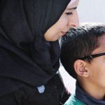Eight-year-old Obeida Ayash 8 and his mother. Click to enlarge