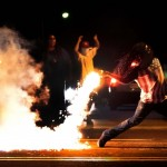 Rioting in Ferguson after Michael Brown was shot dead. Click to enlarge