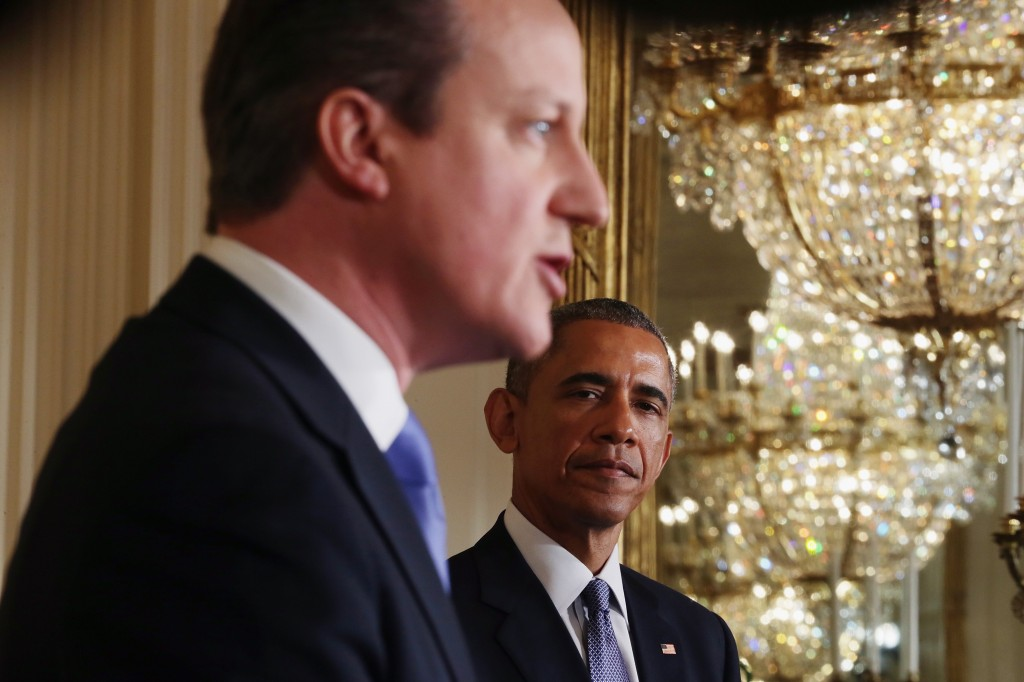 British Prime Minister Cameron speaks during a joint press conference with President Obama. Click to enlarge