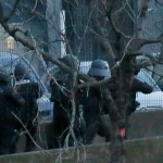 French police special forces launch an assualt on the Kosher supermarket where hostages were being held. Click to enlarge