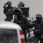Members of French special police forces of Research and Intervention Brigade (BRI) are seen at the scene of a shooting in the street of Montrouge near Paris January 8, 2015.  REUTERS/Charles Platiau