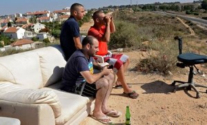 Israelis watch the Gaza bombardment. Click to enlarge