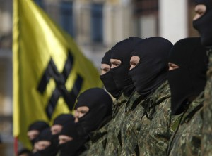 "New volunteers for the Ukrainian interior ministry's ""Azov"" battalion take their oath of allegiance to their country during a ceremony in Kiev. Click to enlarge"