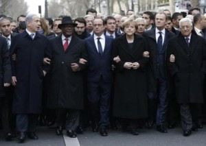 French President Francois Hollande is surrounded by head of states including (L to R) Israel's Prime Minister Benjamin Netanyahu, Mali's President Ibrahim Boubacar Keita, Germany's Chancellor Angela Merkel, European Council President Donald Tusk and Palestinian President Mahmoud Abbas as they attend the solidarity march (Marche Republicaine) in the streets of Paris January 11, 2015. REUTERS/Philippe Wojazer