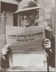 Ignorant British soldier shown laughing as he reads Hitler's leaflet.