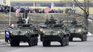 US soldiers attend military parade near the border crossing with Russia on Feb 24, 2015. Click to enlarge