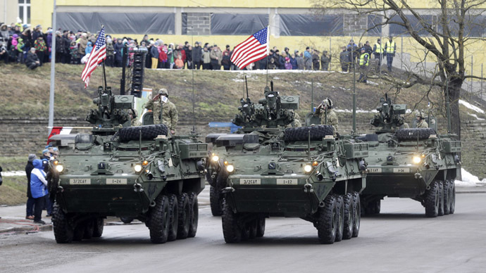 US soldiers attend military parade near an Estonian border crossing with Russia on Feb 24, 2015. Click to enlarge