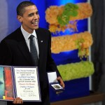 "Accepting the Nobel Peace Prize, Obama's smile says it all: ""you suckers"". Click to enlarge"