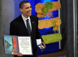 """Accepting the Nobel Peace Prize, Obama's smile says it all: """"you suckers"""". Click to enlarge"""