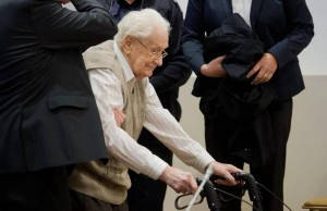 The so-called 'Holocaust accountant,' Oscar Groenig, enters court. Click to enlarge