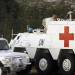 Spanish UN peacekeepers drive an armoured emergency vehicle after picking up the body of a 36-year-old Spanish UN soldier who was killed as Israel shelled border areas in the Lebanese village of Abbassiyeh, January 28, 2015. Click to enlarge