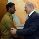 Netanyahu and assaulted soldier Damas Fekade. Click to enlarge