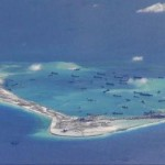 Chinese dredging vessels are purportedly seen in the waters around Mischief Reef in the disputed Spratly Islands in the South China Sea in this still image from video taken by a P-8A Poseidon surveillance aircraft provided by the United States Navy May 21, 2015. REUTERS/U.S. Navy/Handout via Reuters. Click to enlarge