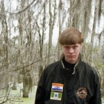 "Dylan Roof, the alleged  killer who is conveniently pictured wearing a jacket with ""racist"" Rhodesian and old South African flags. Click to enlarge"