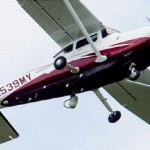 In this photo taken May 26, 2015, a small plane flies near Manassas Regional Airport in Manassas, Va. The plane is among a fleet of surveillance aircraft, which are allegedly used to target suspects under federal investigation. Such planes are capable of taking video of the ground, and some can sweep up certain identifying cellphone data. (AP Photo/Andrew Harnik)