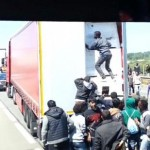 Shock Video: Rioting Migrants Attempt to Hijack Truck Heading For UK