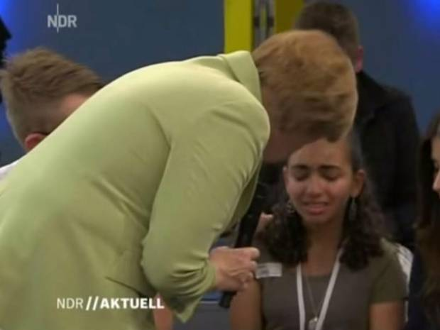 Angela Merkel and the young Palestinian refugee girl whose family faces being deported from Germany