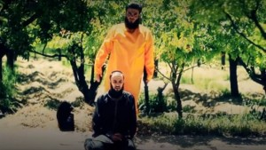 ISIS fighter allegedly about to be beheaded by Free Syrian Army executioner. Click to enlarge