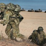 Australian soldiers move to higher ground_during_amphibious assault in exercise Talisman Sabre 2015