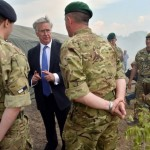 British Defence Secretary Michael Fallon (2L) talks with UK instructors after military exercises on the shooting range of Ukrainian forces near Ghytomyr, some 150 km west of Kiev, on August 11, 2015. The Defence Secretary announced further enhancements of the UK training programme for Ukrainian armed forces while visiting the country. AFP PHOTO/ SERGEI SUPINSKY