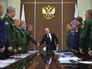 Russian President Vladimir Putin (C) shakes hands with Defence Minister Sergei Shoigu during a meeting at the Bocharov Ruchei state residence in Sochi, November 24, 2014. Click to enlarge