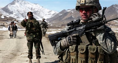 U.S. and Afghan troops on patrol near the town Yawez