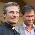Father Krysztof Olaf Charamsa, left, poses with his partner Edouard after telling reporters in Rome that he's gay.