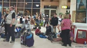 British holidaymakers wait at Sharm el-Sheikh after flights suspended