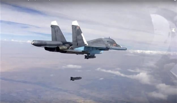 An Sukhoi Su-34 fires a precision guided missile in Syria.