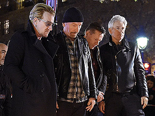 U2 pay homage to the terror victims near the Bataclan Concert Hall