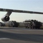 A still from a video of S-400 defense missile systems driving on the tarmac of Hmeymim airbase in Syria. Click to enlarge