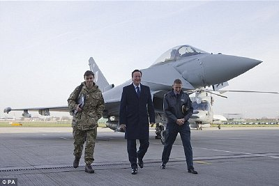Coincidence? David Cameron managed to have his portrait taken next to a very macho-looking Typhoon fighter jet at Northolt RAF base on his way back from Paris earlier this week. Click to enlarge