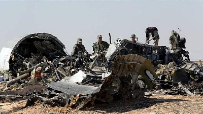 Investigators survey the wreckage of the A321