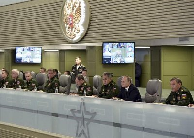 Putin at Air force briefing cap:  Russian President Vladimir Putin (2nd R) with Defence Minister Sergei Shoigu (3rd R) and armed forces Chief of Staff Valery Gerasimov (R) attend a meeting on Russian air force's activity in Syria at the national defence control centre in Moscow, Russia, November 17, 2015. Click to enlarge