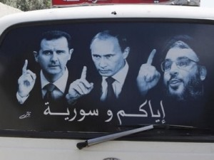 A poster showing Syrian President Bashar al-Assad (L), Russian President Vladimir Putin (C) and Lebanese Hezbollah leader Sayyed Hassan Nasrallah is seen on a micro bus in al-Qardahah town, near Latakia city May 26, 2014. Click to enlarge