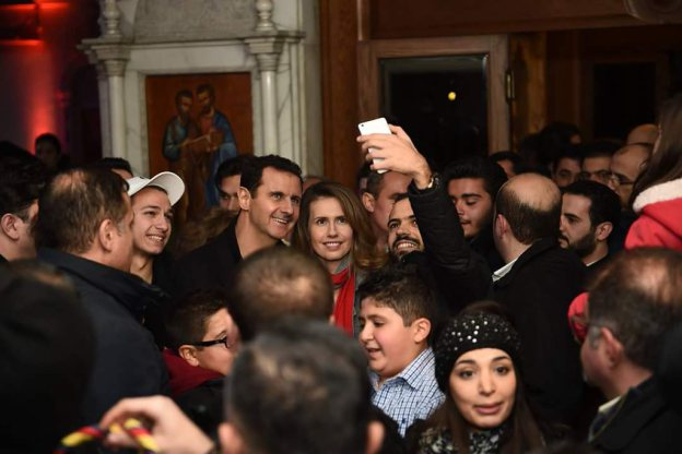 President Assad and his wife in a Damascus suburb recently