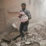 The Guardian's caption reads: A Syrian man carries a baby wrapped in a blanket (or maybe just a blanket. Ed.)  following airstrikes on the town of Douma, a rebel stronghold east of Damascus. Click to enlarge