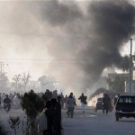 Residents flee as smoke rises over a suicide bomb attack that targeted foreign forces in the Helmand capital, Lashkar Gah Nov, 2015. Click to enlarge