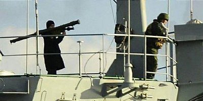 Russian soldier stands with shoulder fired missile launcher at the ready as the ship crosses the Bosphorus. Click to enlarge