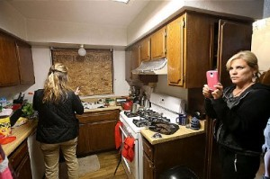 Reporters search through San Bernardino suspects kitchen. Under normal circumstances this would be closed to reporters as it would be a site of police investigations. Click to enlarge