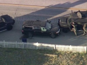 Armored vehicles surround an SUV following a shootout in San Bernardino, Calif., Dec. 2, 2015. Click to enlarge