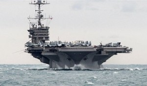 In this Saturday, Dec. 26, 2015 photo released by the U.S. Navy, the aircraft carrier USS Harry S. Truman transits the Strait of Hormuz. Iranian naval vessels conducted rocket tests last week near the USS Harry S. Truman aircraft carrier. Click to enlarge