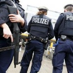 Armed German police secure the main train station in Munich. Click to enlarge