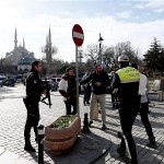 Policemen secure the area after the explosion near the Blue Mosque in the Sultanahmet district of Istanbul. Click to enlarge