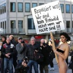 How stupid can you get? Swiss artist Milo Moire holds a sign 'Respect us! We are no fair game even when we are naked!!!'' Maybe somebody should her that her protest will probably only encourage more attacks. But maybe the only way she'll understand that is if she gets forcibly groped and raped. Seriously. The time when European women were treated with courtesy and respect may be coming to an end and Milo Moire antics are only going to hasten that. Click to enlarge